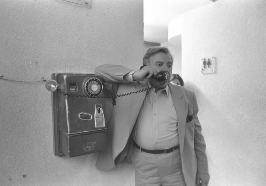 The late Teddy Kollek, legendary mayor of Jerusalem, talks on a public phone. (Photo credit: Nati Harnik / GPO)