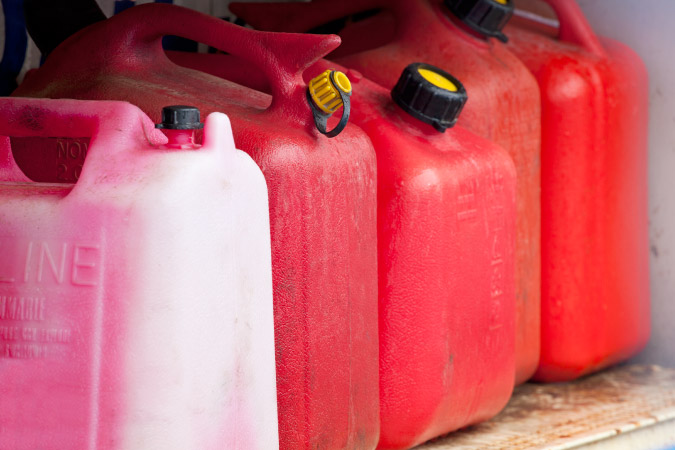 Jugs of gasoline lined up next to each other