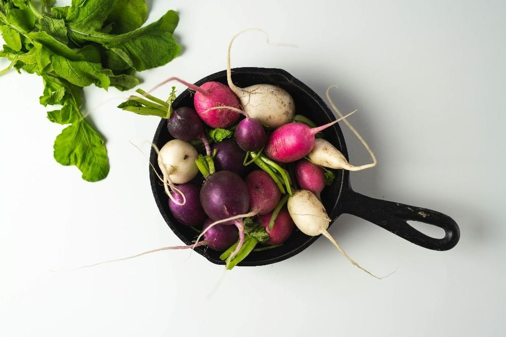 A picture containing indoor, radish, vegetable, fruit  Description automatically generated