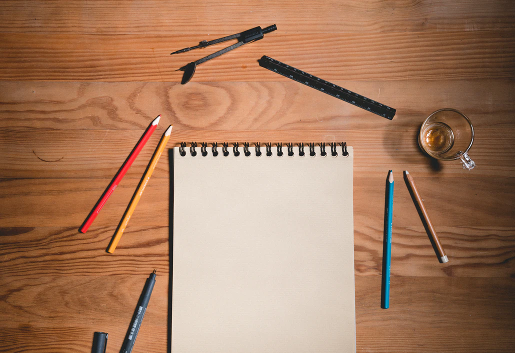 a notepad and drawing tools