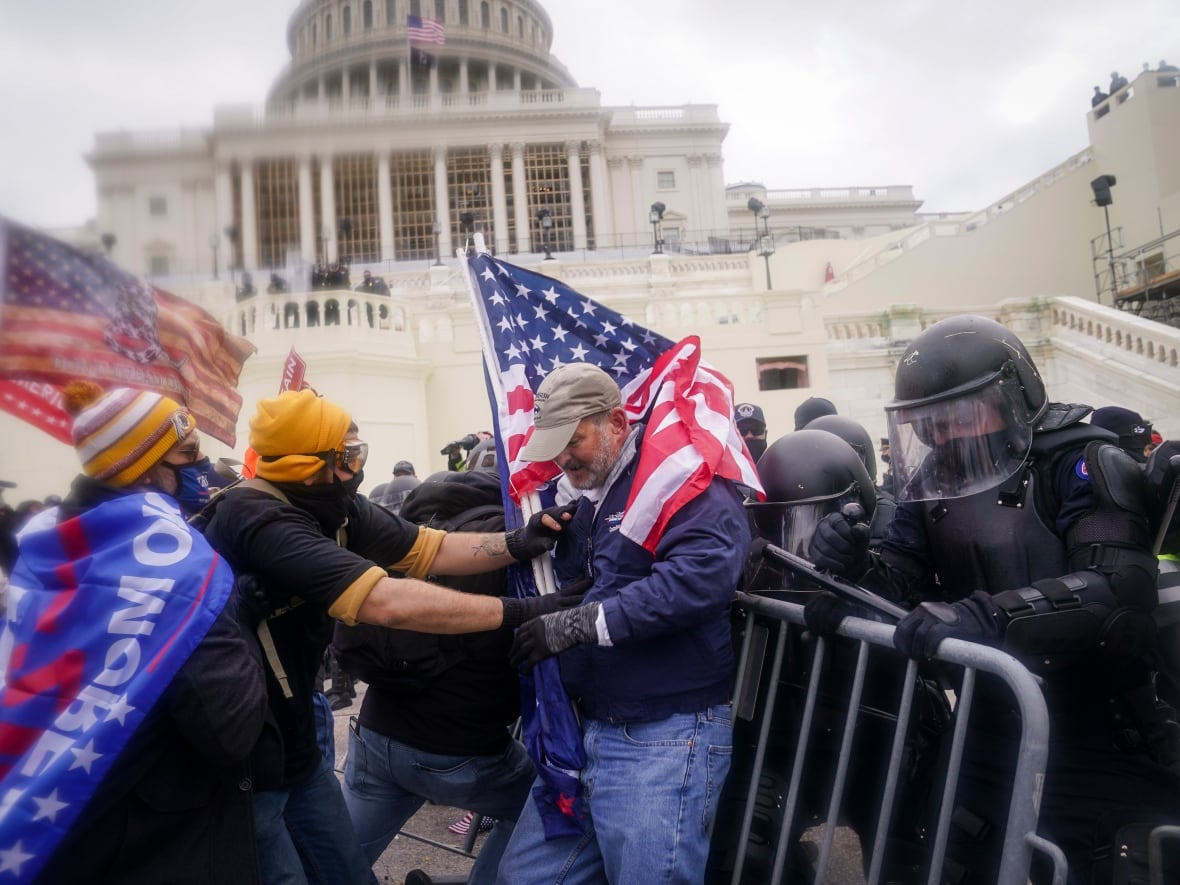 Supporters of President Donald Trump try to break through a police barrier on Wednesday at the U.S. Capitol in Washington, D.C. Congress had been meeting to ratify president-elect Joe Biden's 306-232 electoral college win over Trump. A group of Republican senators said they would reject the electoral college votes of several states unless Congress appointed a commission to audit the election results.