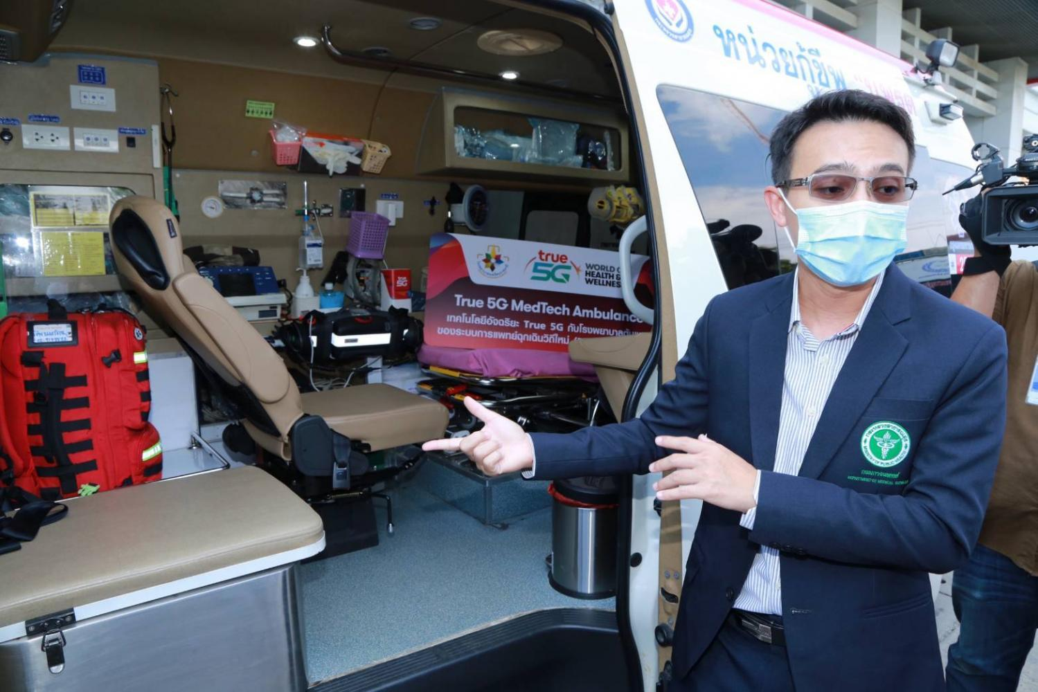 Chalermpon Chairat, chief of the emergency unit at Nopparat Rajathanee Hospital, demonstrates a smart ambulance equipped with 5G.