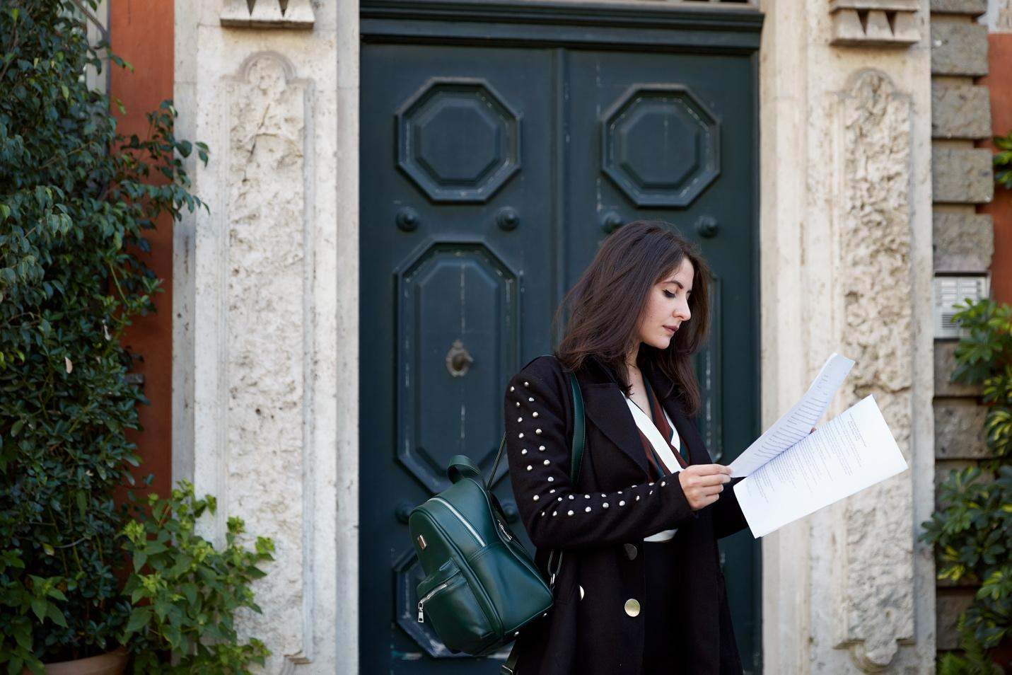 Fashionable students reading notes in the streets of Rome