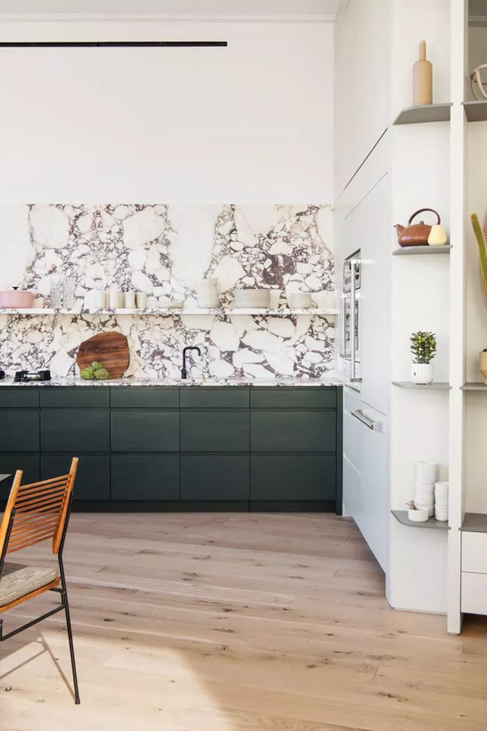 scandinavian minimal kitchen design with marble grey and white backsplash, open floating shelves and wood floors