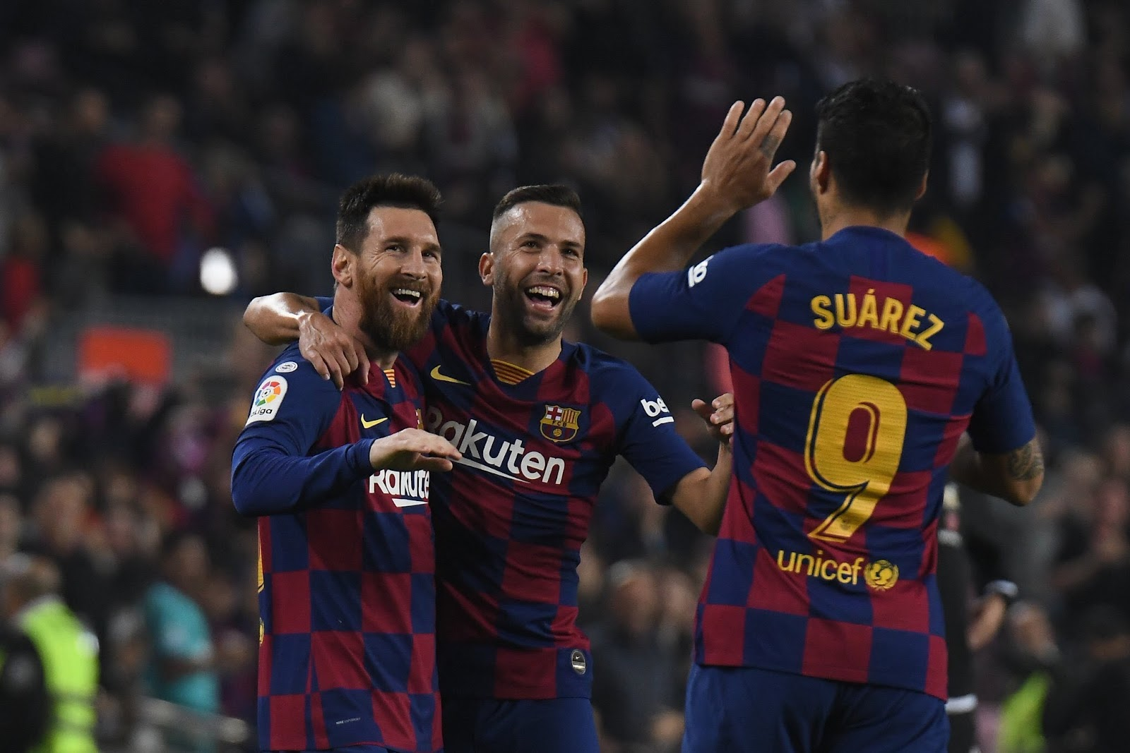 Messi celebrates with Alba and Suarez after scoring against Valadollid in La Liga