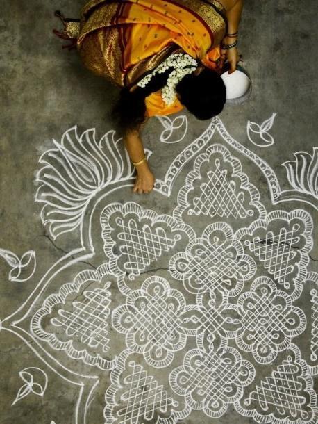"Woman making a kolam in south India: ""Especially during the harvest season,  you'll see many women making kolams outside their …   India art, Mandala, Indian  mandala"