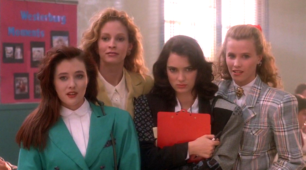 Image of The Heathers standing in a hallway at school