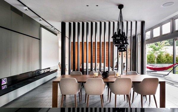 Vách ngăn gỗ giữa phòng khách và bếp kết hợp kệ tivi