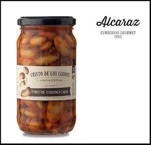 Porotos blancos cocidos condimentados con pimentón, orégano y ají molido, envasados en aceite de girasol