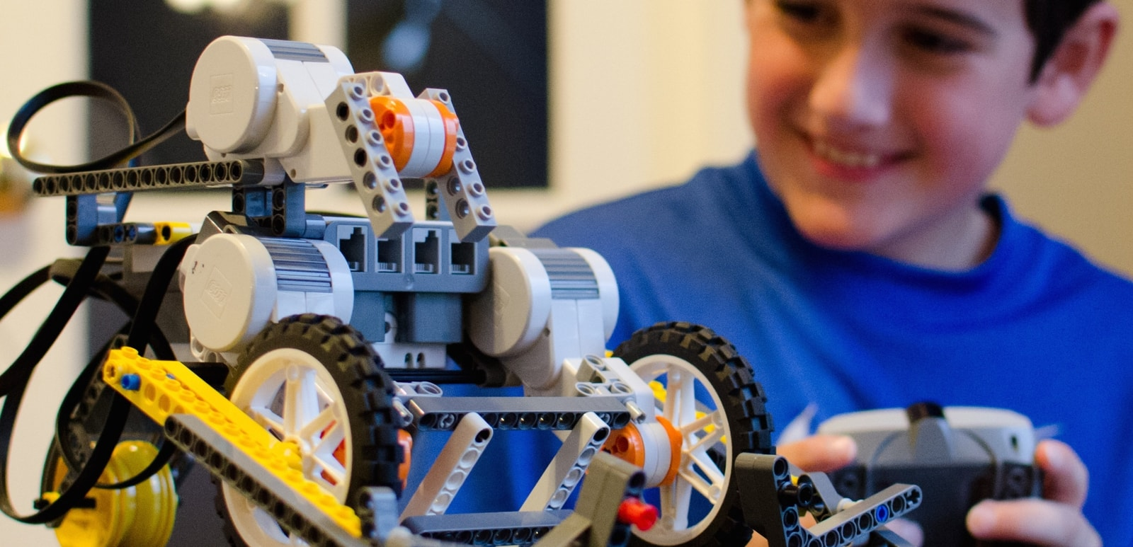 young boy laying with LEGO Robotics