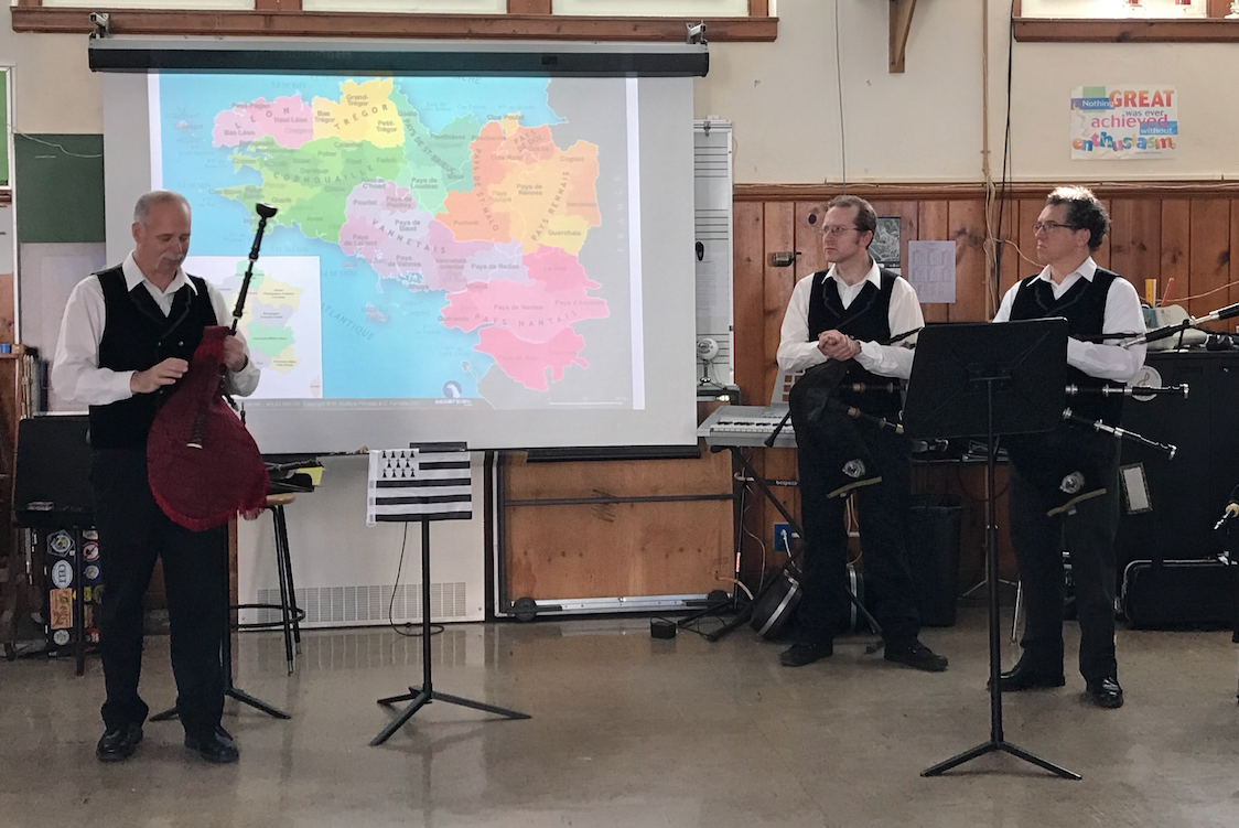 Celtic musicians perform for the students.
