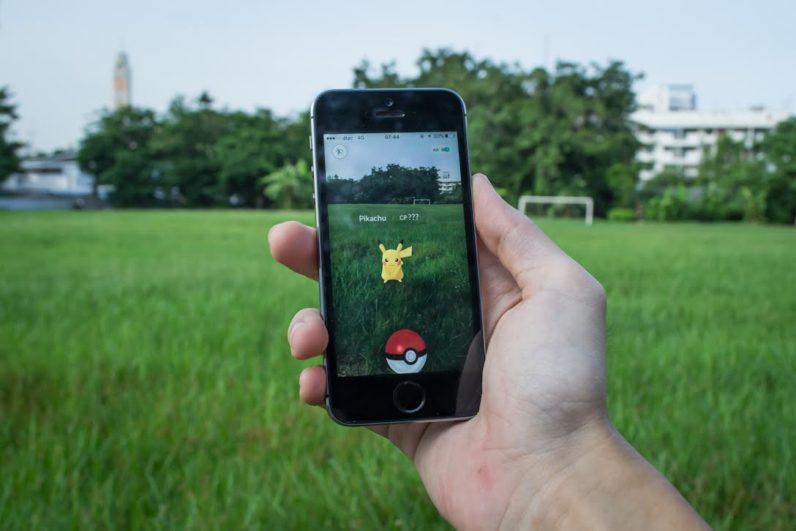 iPhone showing augmented reality of Pokemon GO.