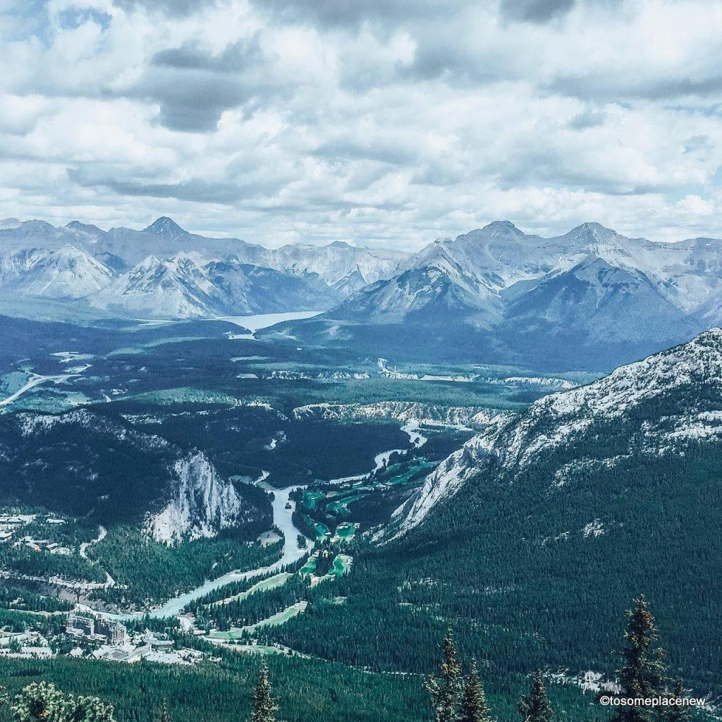 View from Gondola Summit in Banff Canada. The perfect 5 day Banff Itinerary for non-hikers. Enjoy a gondola ride, hot springs with mesmerising mountain views, relax by lakes & gardens in Banff!