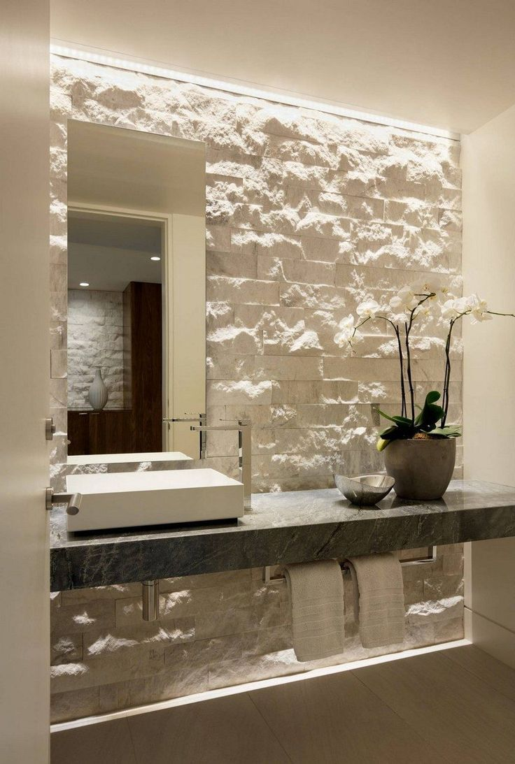 modern bathroom with stone accent wall backsplash, updated modern finishes and a white square sink