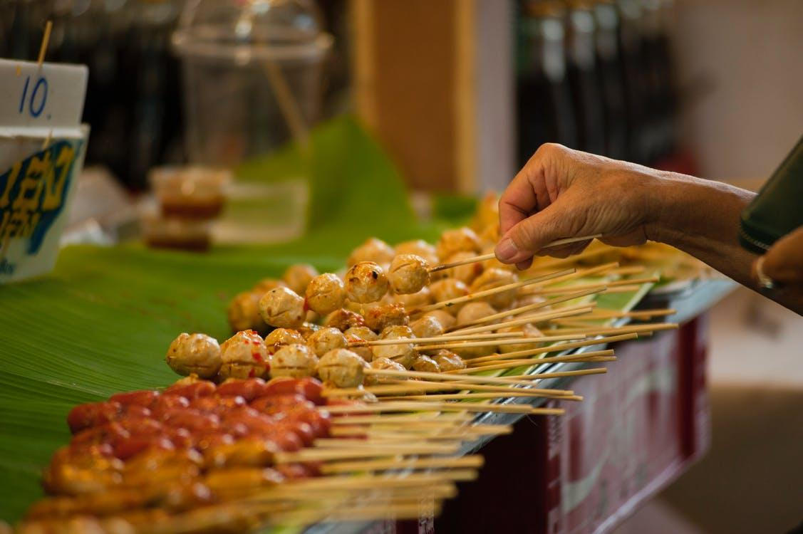 Tilt Shift Photography of Street Foods in Stick