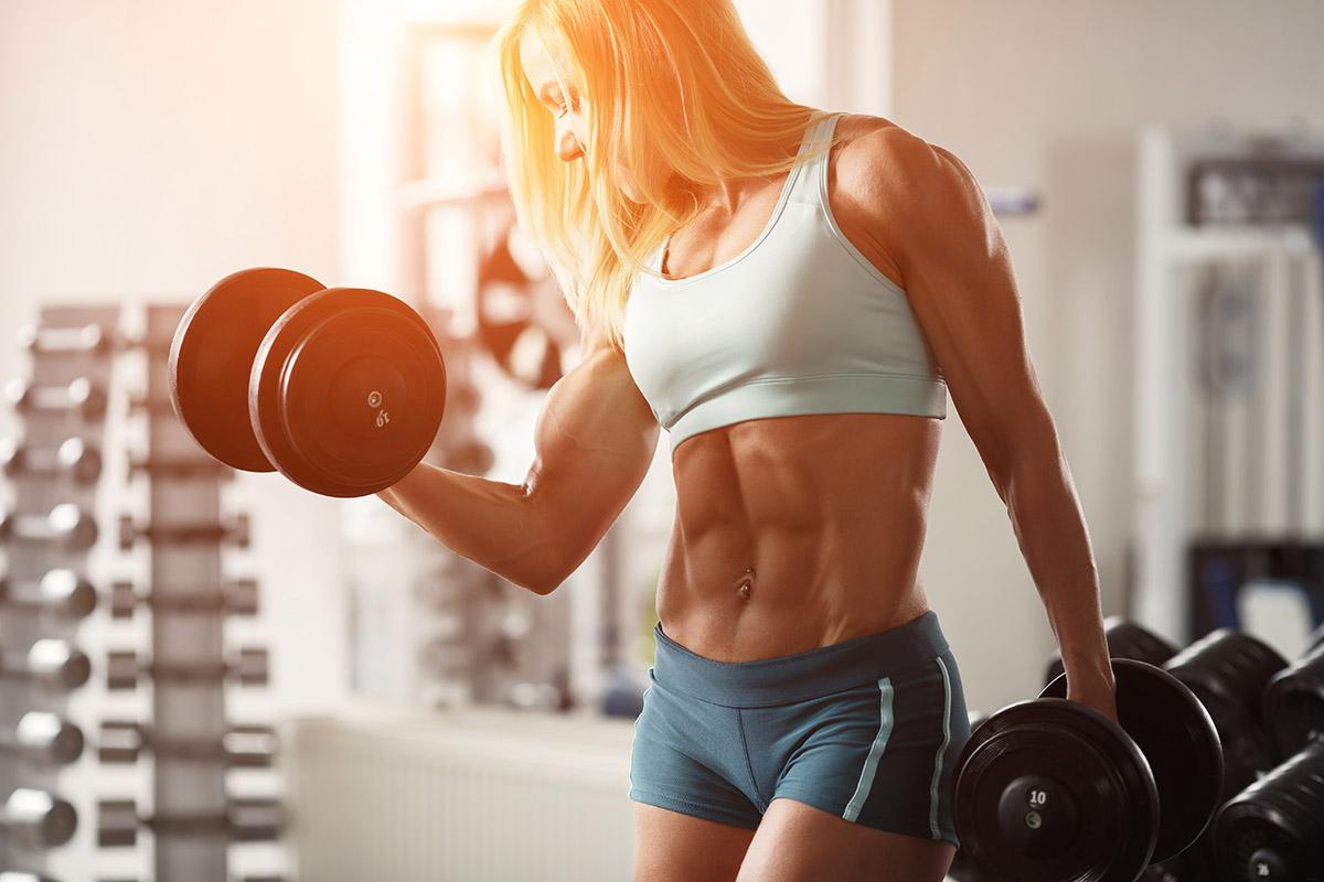 Female bodybuilder lifting weights