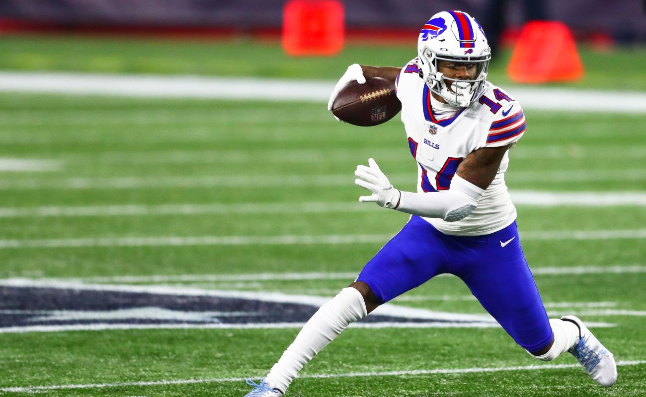 Stefon Diggs #14 of the Buffalo Bills runs with the ball during a game against the New England Patriots at Gillette Stadium on December 28, 2020 in Foxborough, Massachusetts. (Photo by Adam Glanzman/Getty Images)