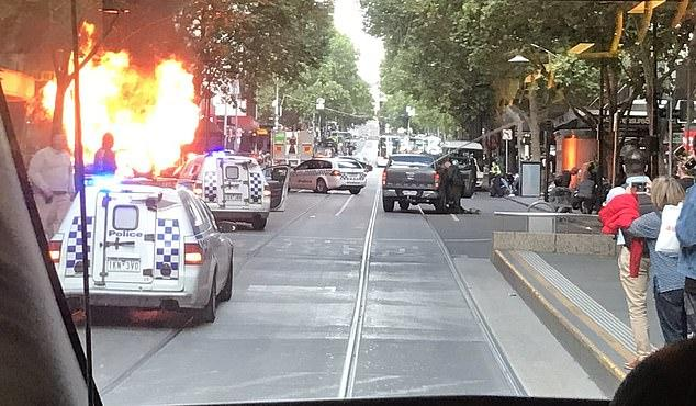 5968198-6370669-A_car_has_crashed_on_Melbourne_s_Bourke_Street_Mall_and_burst_in-m-35_1541742464176