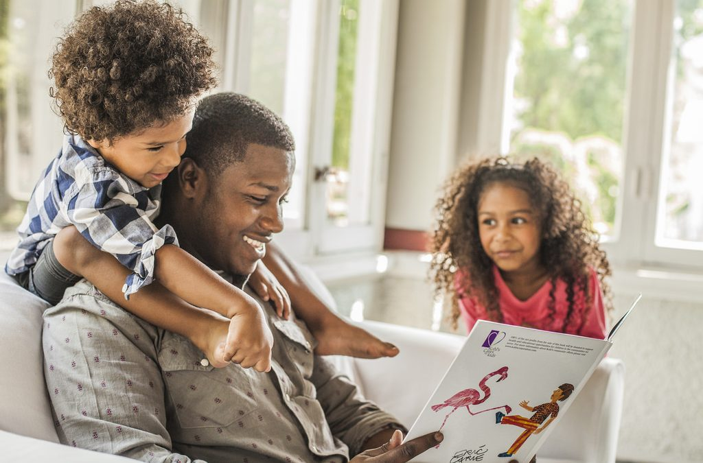 New Mexico family portrait depicts parent reading to children.