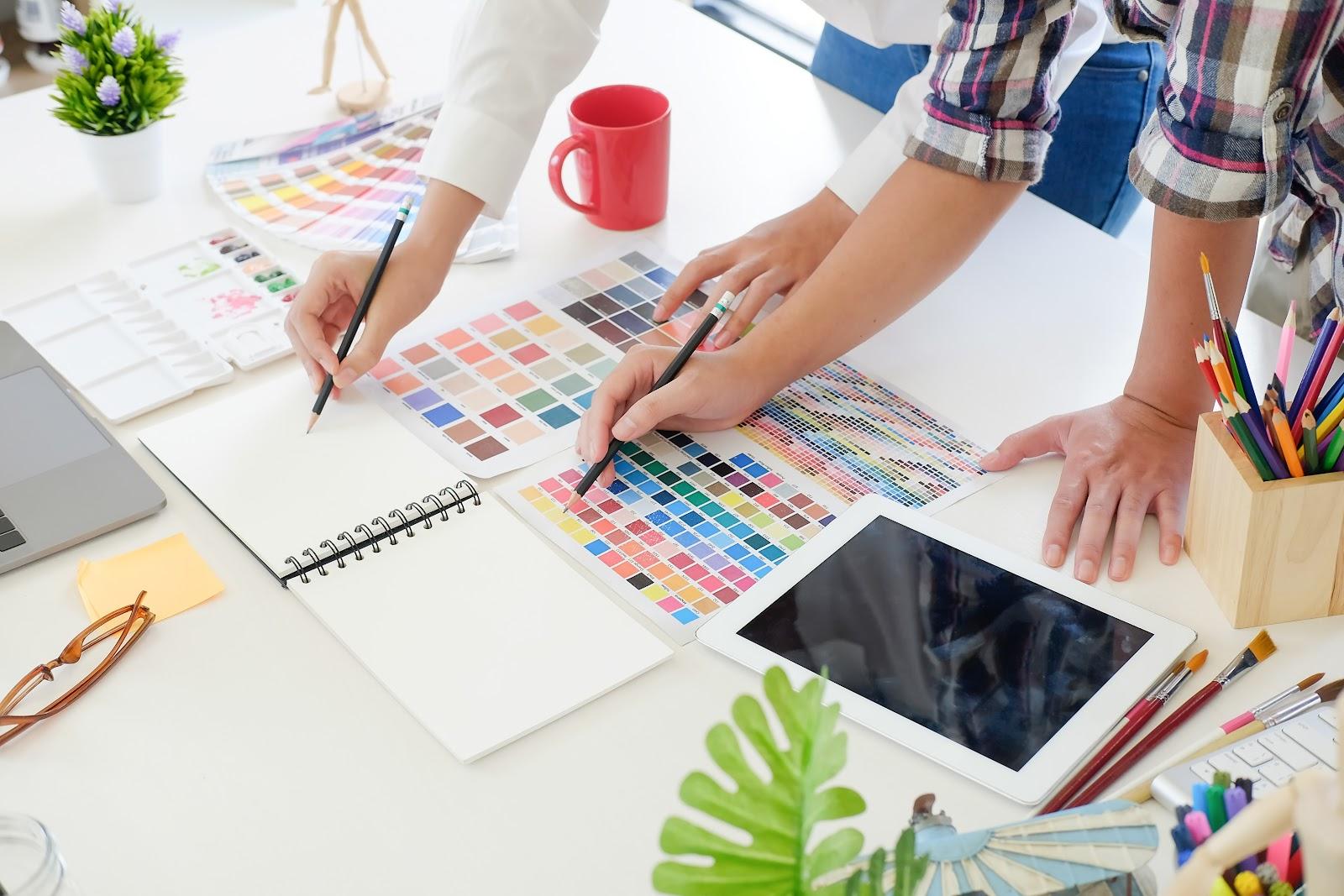 Designer hands and color palettes