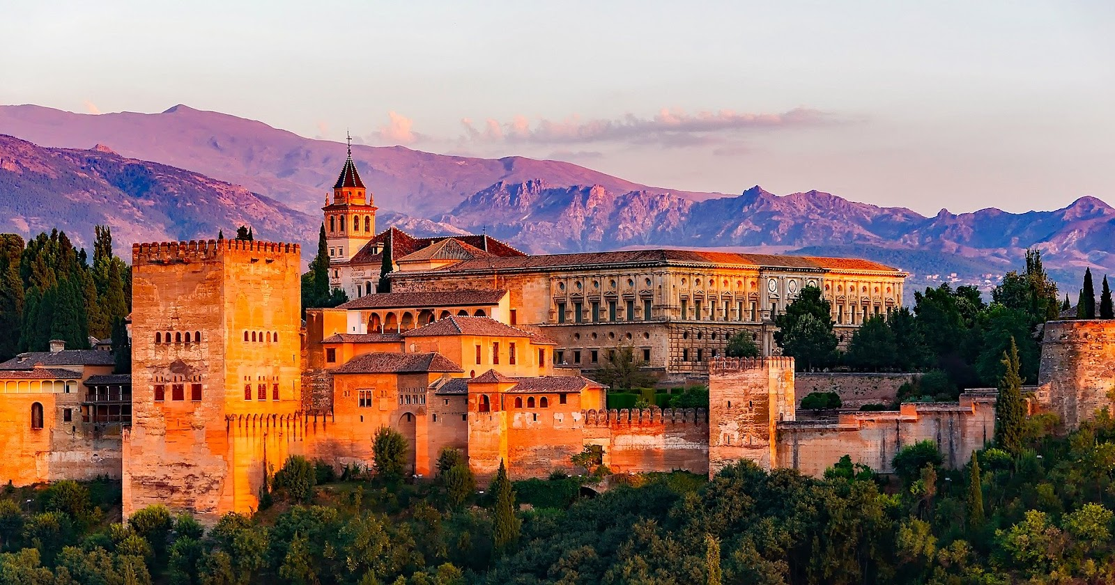 granda alhambra palace with mountains in background during sunset spain tourism