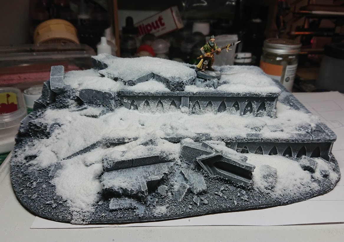 A Frostgrave barbarian on a finished piece of ruined terrain.