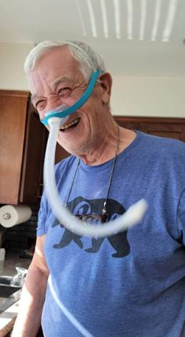 Happy cpapRX patient enjoying his new Evora Nasal Mask by Fisher & Paykel