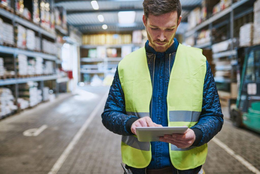 Worker performing task on tablet