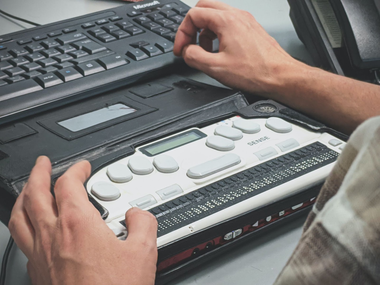 A person using a braille keyboard