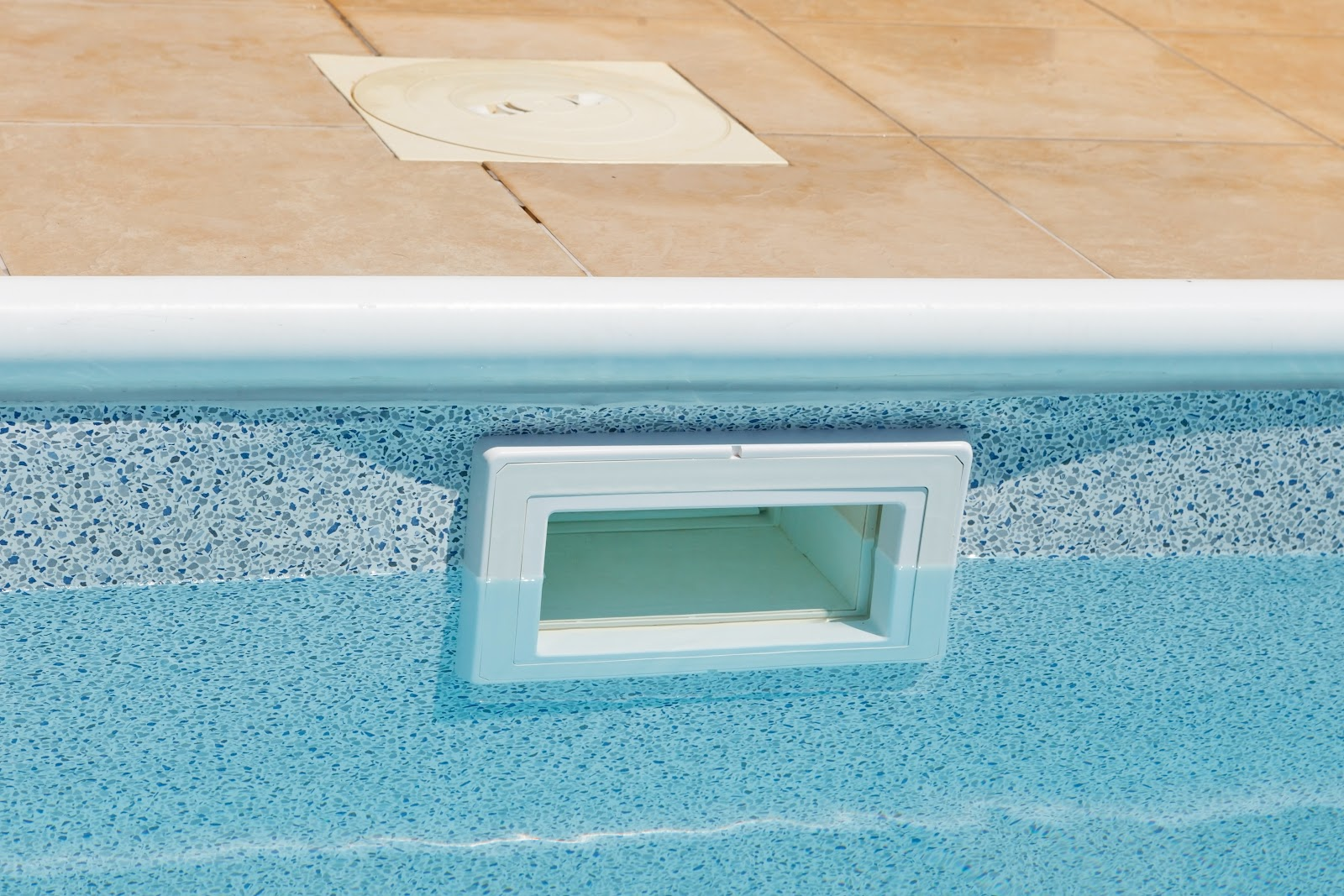 inground pool skimmer submerged by more than an inch of water