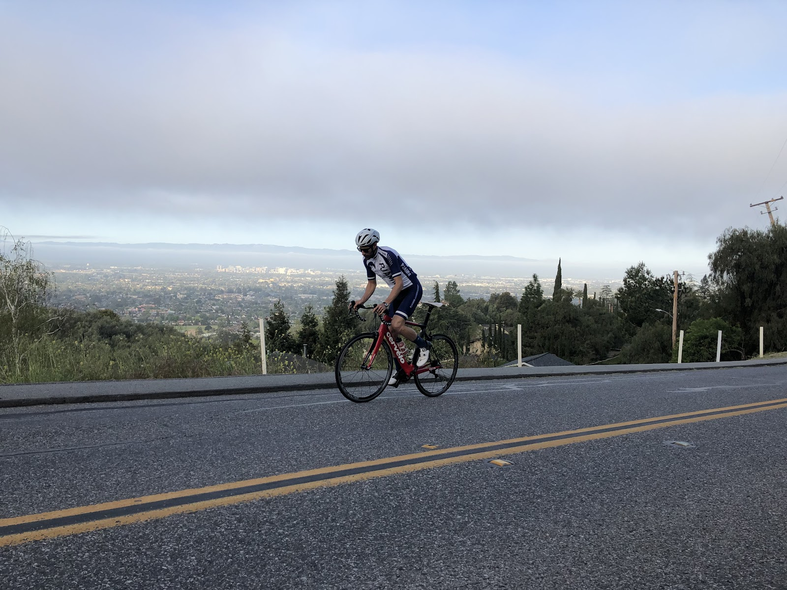 Cycling Mt. Hamilton  - cyclists on bike on road with San Jose and Silicon Valley in background
