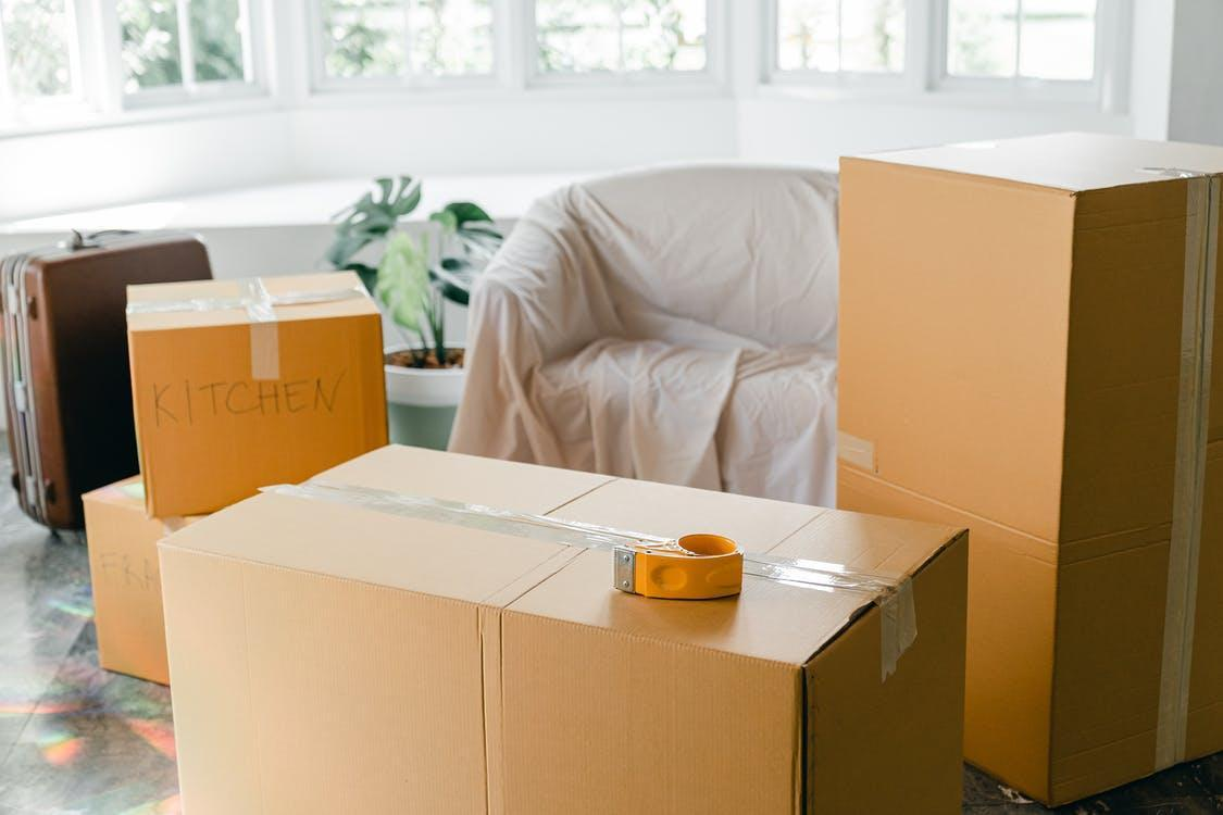Empty apartment with packed carton boxes before moving