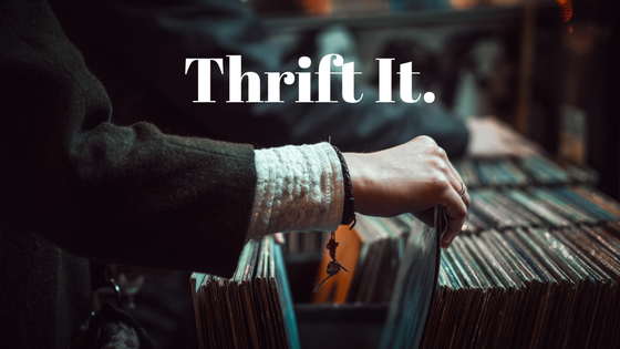 person sorting through vintage vinyl records with the words Thrift It superimposed over photo