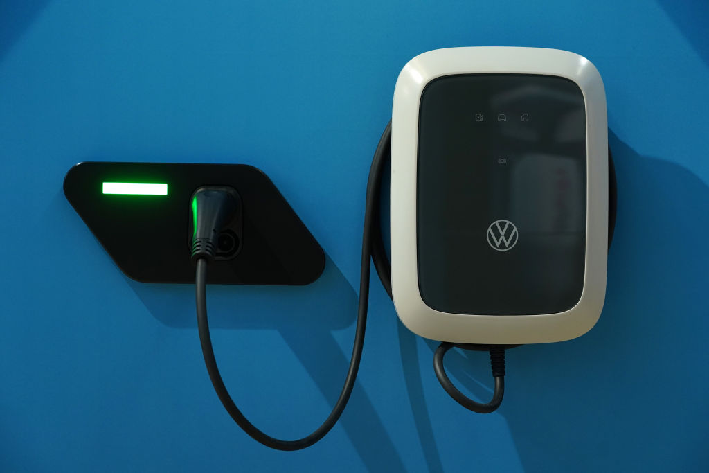 A wall charger for Voltswagen ID.3 and ID.4 electric cars hangs on display at the Autostadt promotional facility next to the Volkswagen factory on October 26, 2020 in Wolfsburg, Germany. While L2 wall charger costs $649 before installation, cost of fuel savings still do not offset the dramatic premium electric vehicles cost compared to their combustion engine counterparts.