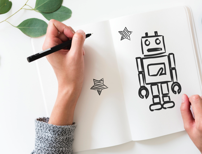 person-holding-black-pen- drawing of a chatbot, how to use chatbots for marketing