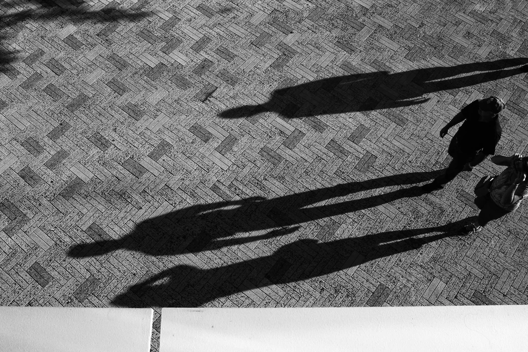 shadows of three people
