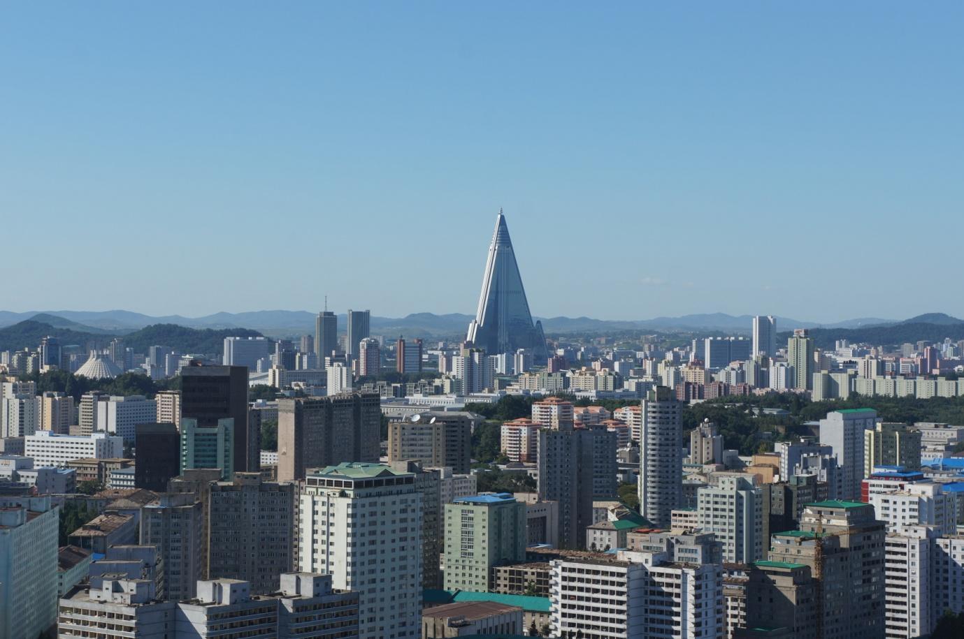 Pyongyang_City_-_Ryugyong_Hotel_in_Background_(13913572409).jpg
