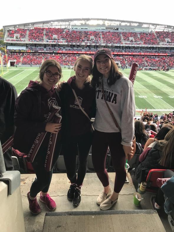 Three uOttawa's Telfer students at Gee-Gees game
