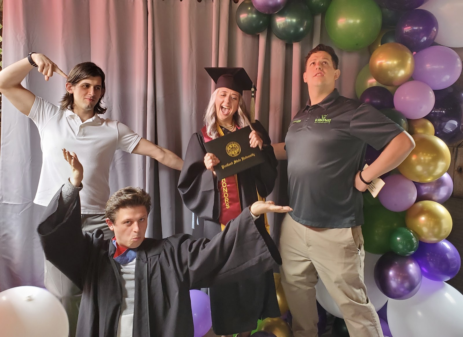 Heather and her three sons celebrating her graduation