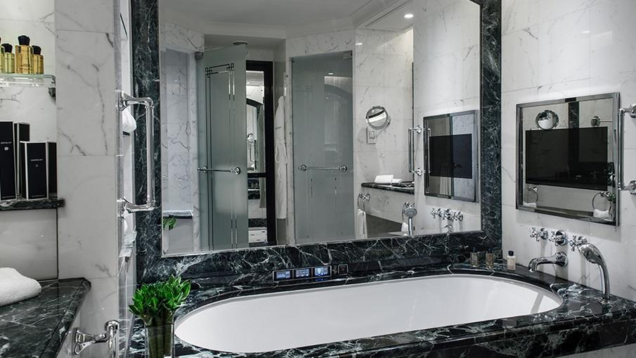 A Bathroom With A Large Bathtub  Description Automatically Generated With Low Confidence