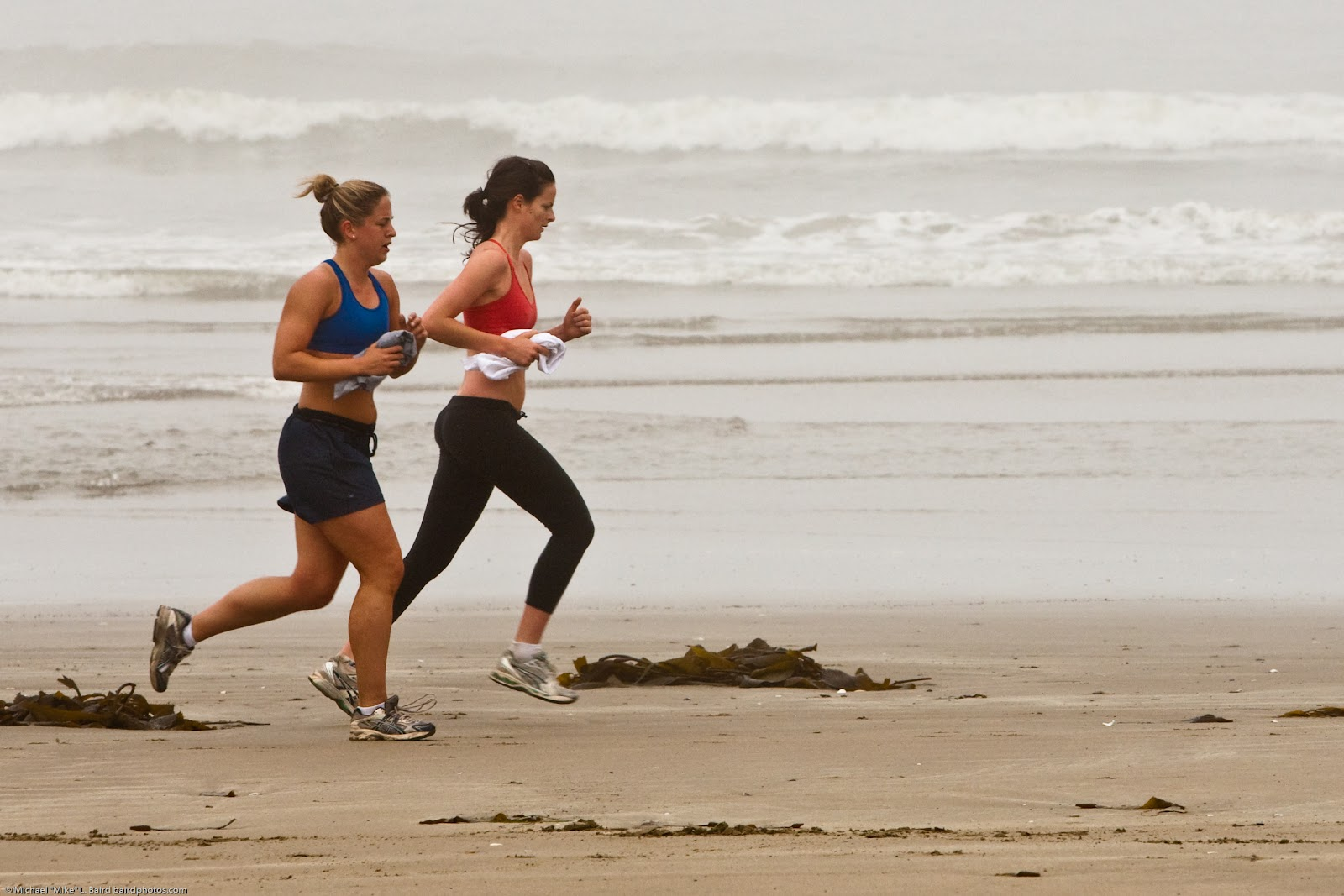 Female_joggers_on_foggy_Morro_Strand_State_Beach.jpg