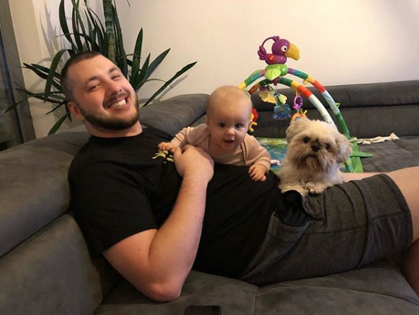 P4wnyhof smiling with his new baby and dog.