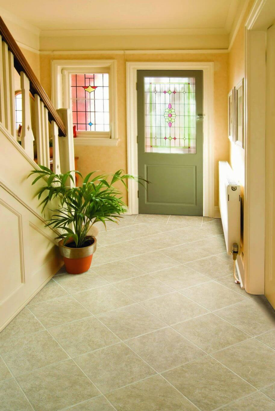 Diagonal square stone-look tile in a home's entranceway