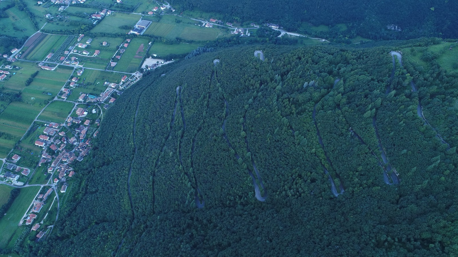 Cycling Monte Grappa from Semonzo - aerial drone photo of hairpins and forest