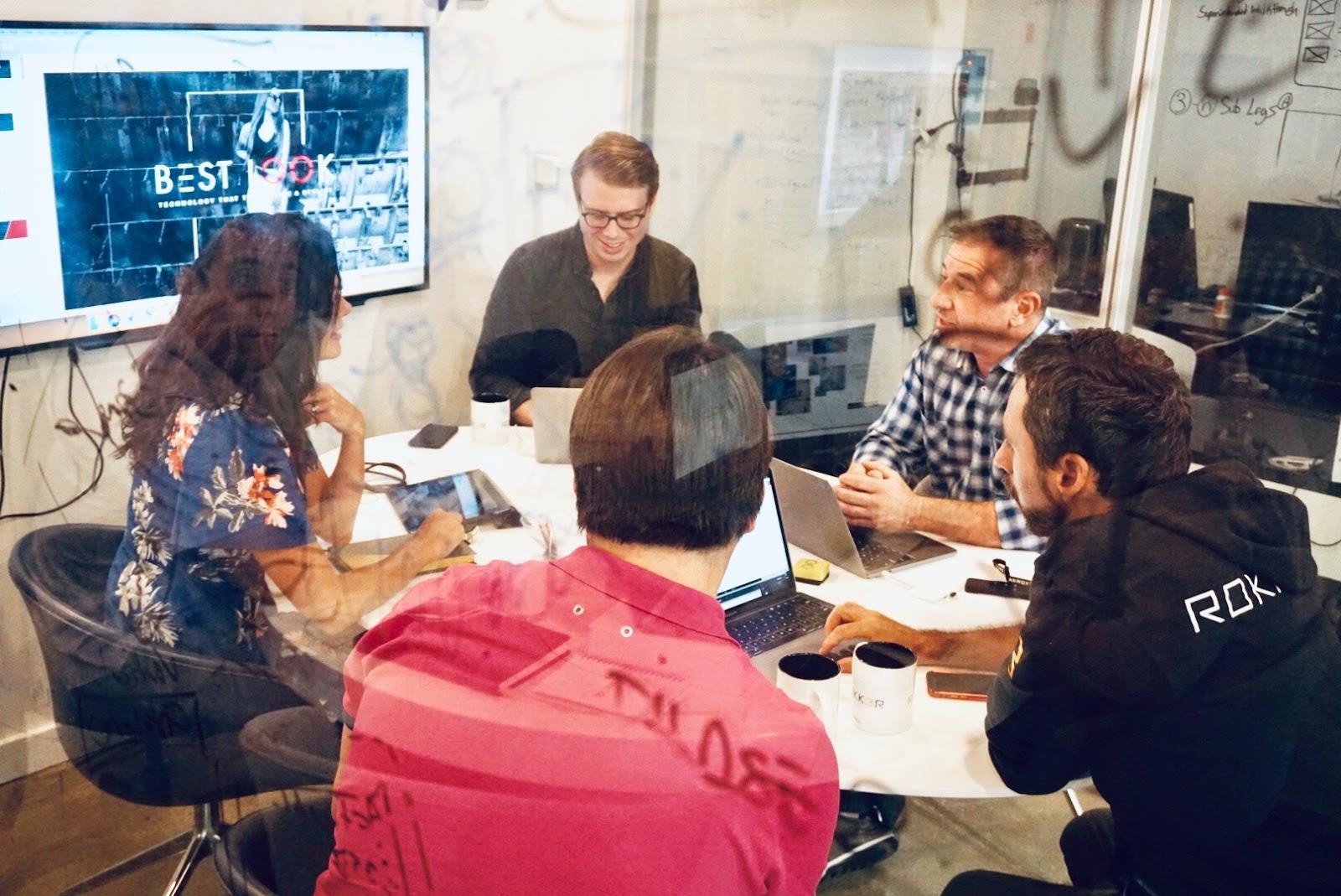 Rokk3r team members during a meeting