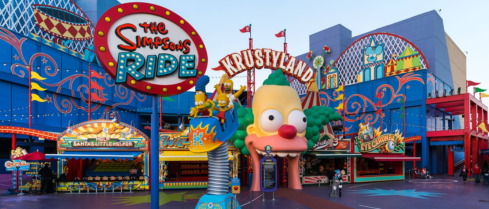 "Characters from ""The Simpsons"" sitting in a roller coaster in front of Krustyland at Universal Studios."