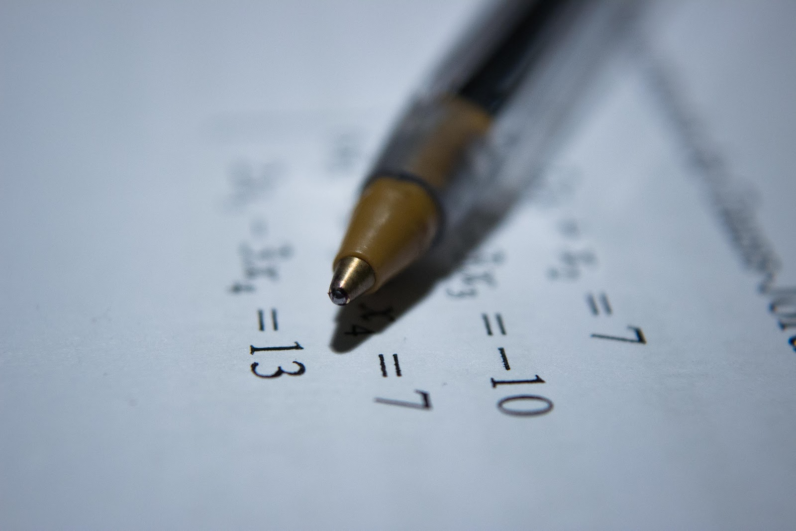 A pen being used in some mathematical problems.