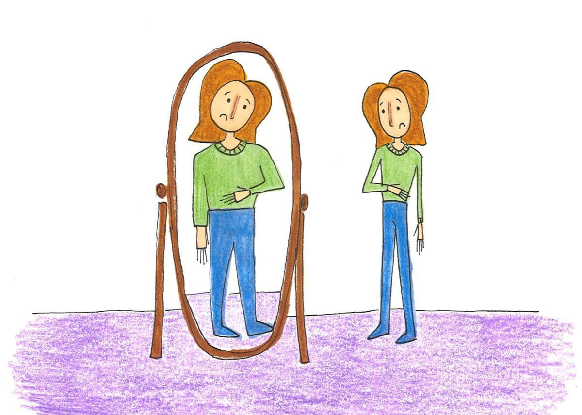 woman looking at the mirror and seeing herself much fatter than she actually is