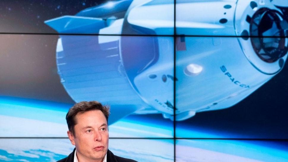 SpaceX chief Elon Musk speaks during a press conference after the launch of SpaceX Crew Dragon Demo mission at the Kennedy Space Center in Florida on March 2, 2019. - NASA and SpaceX celebrated the successful launch March 2 of a new astronaut capsule on a week-long round trip to the International Space Station -- a key step towards resuming manned space flights from US soil after an eight-year break. (Photo by Jim WATSON / AFP) (Photo by