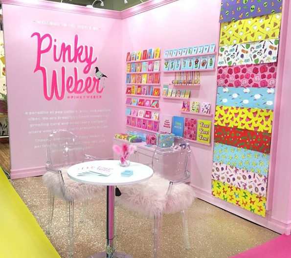 a pink banner stand